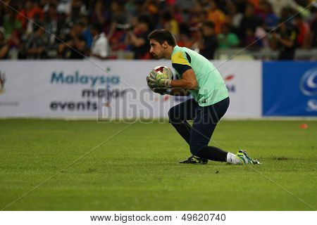 KUALA LUMPUR - AUGUST 9: FC Barcelona'goalkeeper Victor Valdes catches the ball during training at the Bukit Jalil Stadium on August 09, 2013 in Malaysia. FC Barcelona is on an Asia Tour to Malaysia.