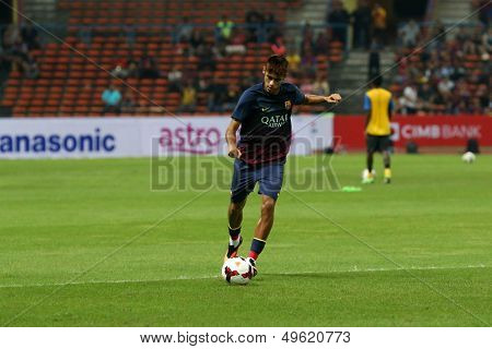 KUALA LUMPUR - AUGUST 10: FC Barcelona 's Neymar Jr. kicks the ball during warm-up before the game against Malaysia at the Shah Alam Stadium on August 10, 2013 in Malaysia. FC Barcelona wins 3-1.