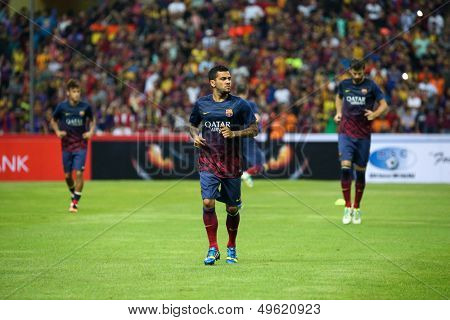 KUALA LUMPUR - AUGUST 10: FC Barcelona 's Dani Alves (center) jogs during warm-up before the game against Malaysia at the Shah Alam Stadium on August 10, 2013 in Malaysia. FC Barcelona wins 3-1.