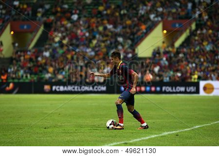 KUALA LUMPUR - AUGUST 10: FC Barcelona's Neymar (maroon/blue) attack in a game against Malaysia played at the Shah Alam Stadium on August 10, 2013 in Malaysia. FC Barcelona wins 3-1.