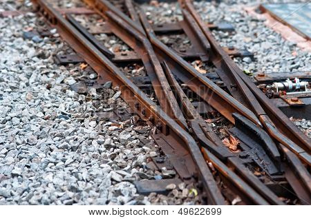 Old railway tracks and inter twining together and crossing over each other