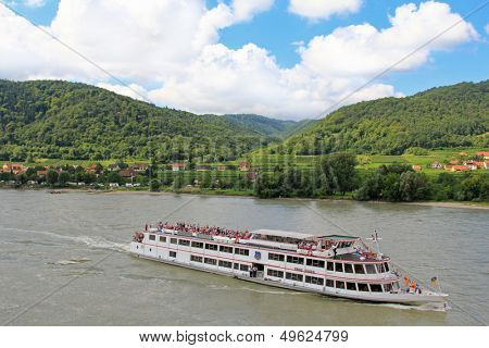 WACHAU, AUSTRIA - AUGUST, 2012 : Tourists cruises along the Danube river, Wachau, Austria on August 12, 2012.