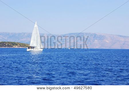 idyllic marine ladscape with yacht