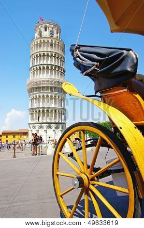 Pisa tower with horse carridge in front of