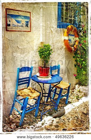traditional Greece - old chairs in taverna- retro styled picture