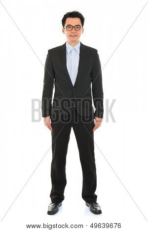 Confident full body Asian business man in formal full suit standing isolated on white background