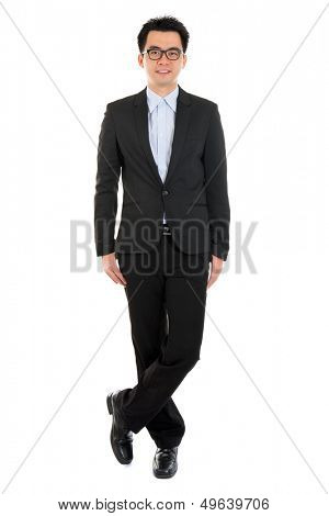Handsome full body Asian business man in formal full suit standing isolated on white background
