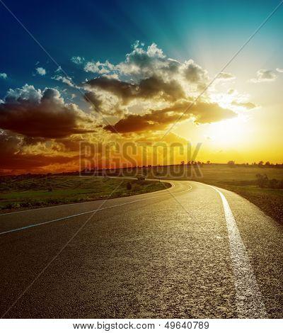 perfect sunset over asphalt road