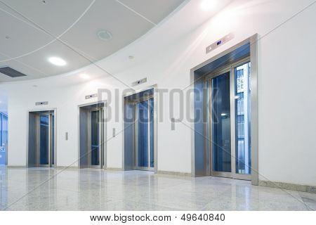Four glass elevator door in the business building