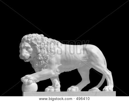 Sculpture Of Lion With The Paw On The Ball