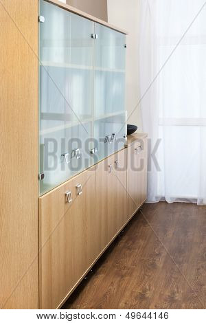bookcase with glass doors in the office