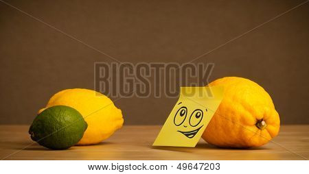 Lemon with sticky post-it note reacting to citrus fruits