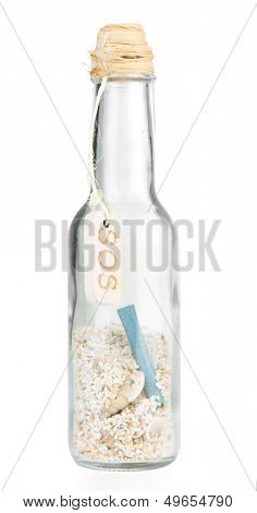 Glass of bottle with note inside on isolated on white