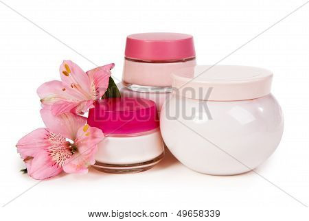 Cosmetic Cream For Make-up And Fresh Flowers Isolated On White Background