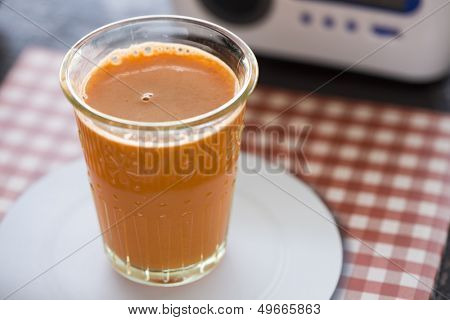 Freshly pressed carrot juice in a clear glass