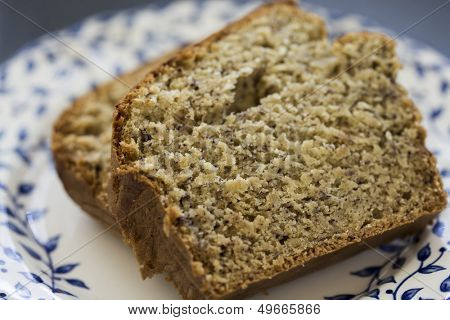Two slices of freshly baked banana bread served on a plate