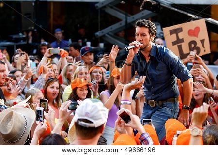 NEW YORK-AUG 16: Singer Luke Bryan performs on NBC's Today Show at Rockefeller Plaza on August 16, 2013 in New York City.