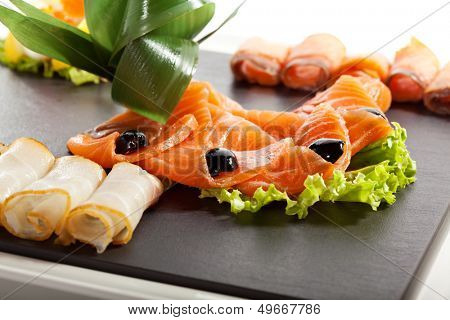 Fish Dish with Lemon, Salad Leaf and Olives