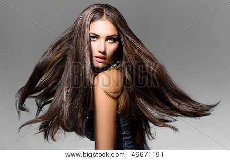 Fashion Model Girl Portrait with Long Blowing Hair. Glamour Beautiful Woman with Healthy and Beauty poster
