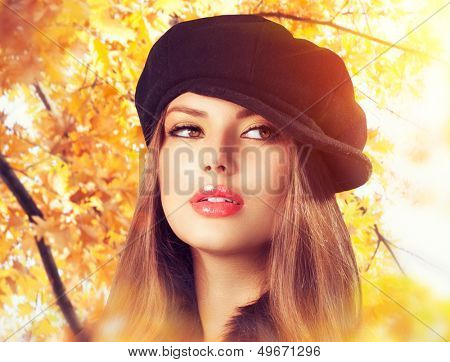 Autumn Woman in a Beret. Hat. Fashion Autumn and Winter Wear. Beauty Girl in Headdress