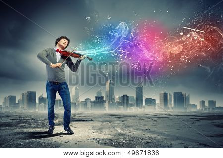 Image of young handsome man playing violin