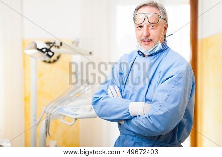 Portrait of a dentist in his clinic