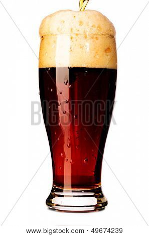 glass of fresh dark beer cut out from white