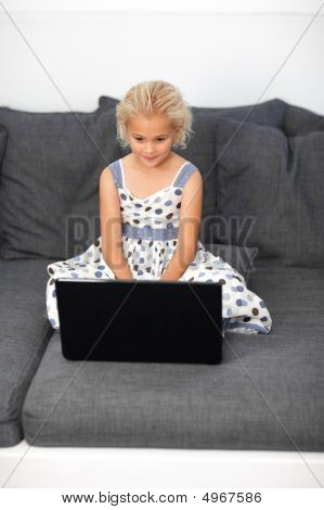 Young Girl Using A Laptop At Home