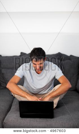 Man Working On Laptop At Home