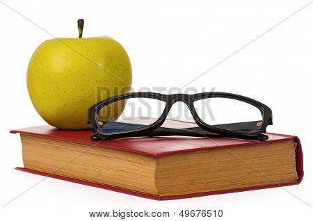 Black eye glasses and old book isolated on white background