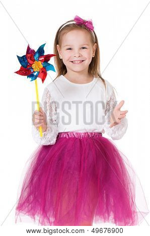 Portrait of little girl holding weathercock, isolated on white background