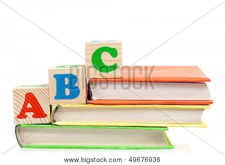 Alphabet letter ABC blocks for kids on books isolated on white background
