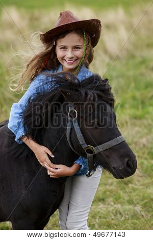 Ranch - Lovely girl with pony on the ranch