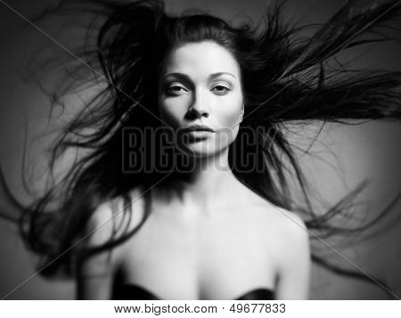 Black and white art portrait of a beautiful young lady