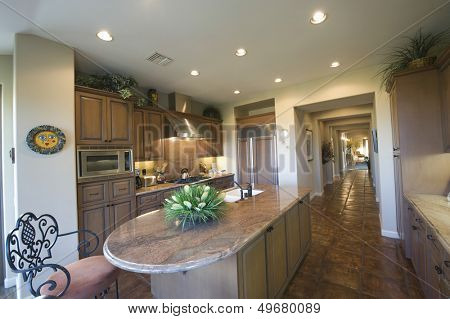 View of marble worktop in spacious kitchen at home