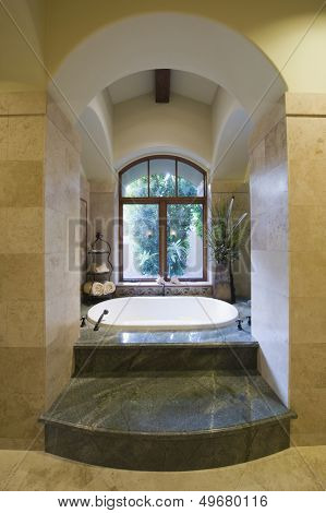 View of sunken marble bath at home
