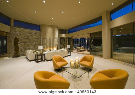 Modern armchairs in spacious living room with view of sitting area in background