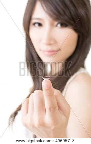 Young asian woman with lens in her hand, on the white background.
