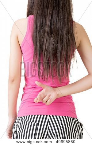 Young asian woman keeps fingers crossed. Rear veiw. Isolated on the white background.