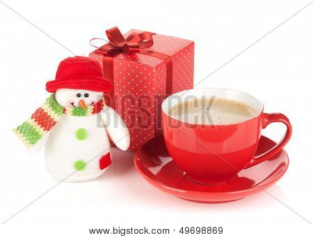Red coffee cup, gift box and snowman toy. Isolated on white background