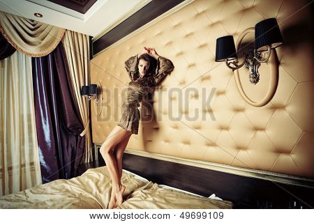 Sexual young woman in a bedroom.