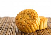 Traditional brown mooncakes. Chinese mid autumn festival foods. The Chinese words on the mooncakes m