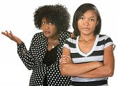 image of disrespect  - Teen with folded arms next to frustrated mother - JPG