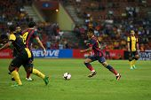 KUALA LUMPUR - AUGUST 10: FC Barcelona's Neymar (maroon/blue) leads in attack against the Malaysian