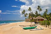 tropical solitude - beach scene with boat. Sri lanka