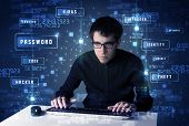 stock photo of illegal  - Hacker programing in technology enviroment with cyber icons and symbols - JPG