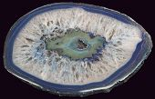 picture of agate  - cross section of blue agate isolated on black background - JPG