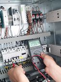 pic of contactor  - Engineer makes maintenance of power network automation system - JPG