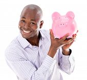 Happy business man with a piggybank - isolated over white background