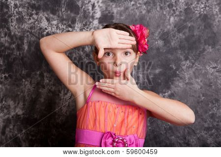 Young Girl Using Hands To Frame Her Face